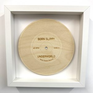 Born Slippy wood record in white frame