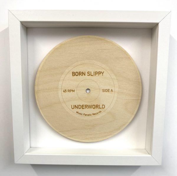 Born Slippy wood record in white frame
