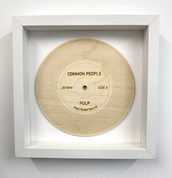 Common People wood record in white frame