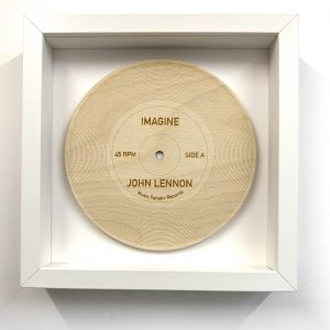 wood record Imagine in white frame